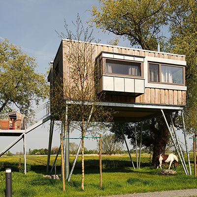 Spend the night in the futuristic looking tree houses on the Elbe island Krautsand